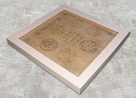Seven Seals framed amulet lying Sm